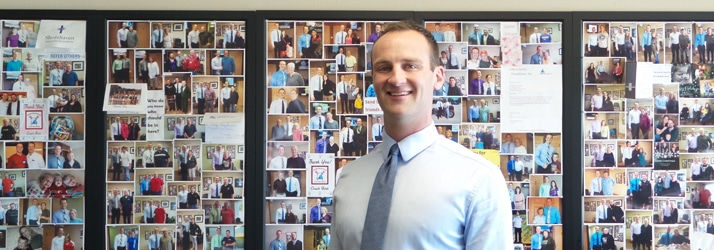 Chiropractor Hartland WI Seth Barr in front of picture board