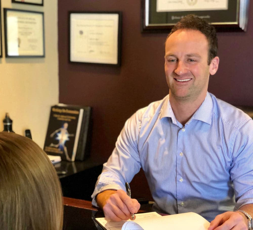 Chiropractor Seth Barr Consulting Patient